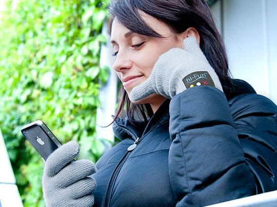 Bluetooth-enabled Handset Gloves from Think Geek let you take a call like this.