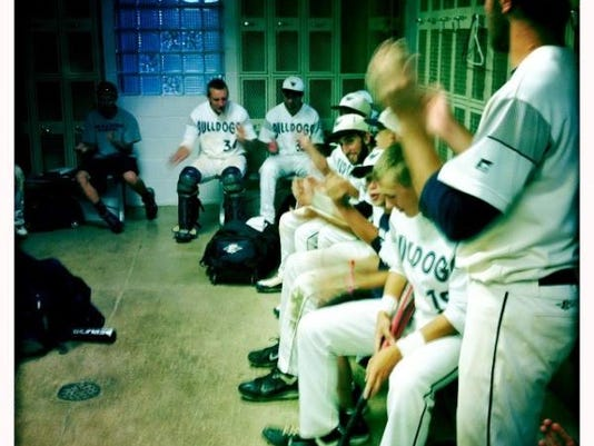 """West York kills time during a rain delay with a sing along. We believe it to be a rendition of the Backstreet Boys """"I Want it That Way."""""""