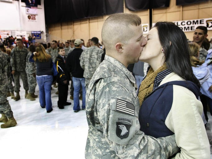 Pfc. Joseph Kelly gives Emily one last kiss as the