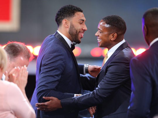 Denzel Valentine, left, and agent B.J. Armstrong celebrate after the Chicago Bulls selected Valentine with the 14th overall pick at Thursday's NBA draft.
