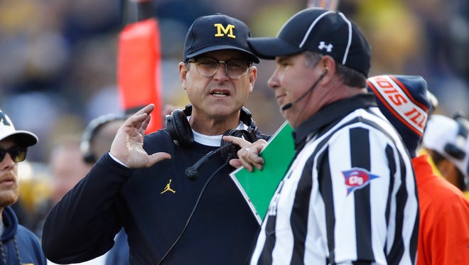 Michigan football coach Jim Harbaugh works against Illinois on Oct. 22, 2016, at Michigan Stadium in Ann Arbor.