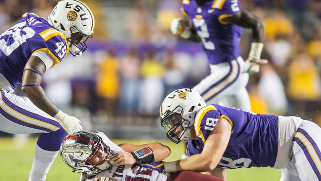 LSU Tigers defensive end Christian LaCouture (18) makes a quarterback sack against Troy Saturday Sept. 30, 2017 in Death Valley.