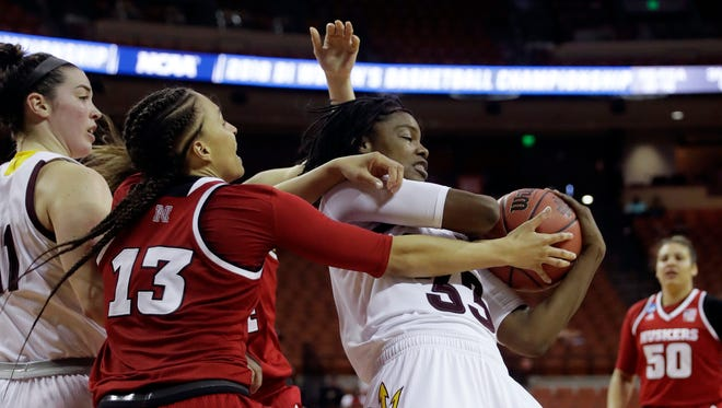 Arizona State center Charnea Johnson-Chapman (33) and Nebraska guard Janay Morton (13) battle for control of a rebound during a first-round game in the NCAA women's college basketball tournament, Saturday, March 17, 2018, in Austin, Texas. (AP Photo/Eric Gay)
