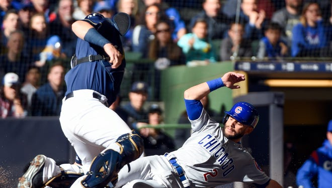 Brewers catcher Jett Bandy tags out Chicago Cubs second baseman Tommy La Stella trying to score in the fifth inning.