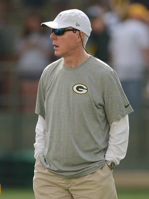 Green Bay Packers general manager Ted Thompson looks on during training camp practice Saturday, July 26, 2014, at Ray Nitschke Field.