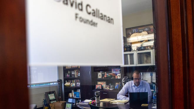 David Callanan, co-founder of AE Wealth Management, works from his office May 19. Callanan is one of the few AE employees still operating from the office, as most continue to work from home.