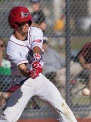 Tulare Western's David Alcantar bats against Tulare