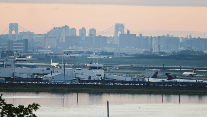Planes navigate LaGuardia Airport  Tuesday, Sept. 16, 2014, in New York. (AP Photo/Frank Franklin II)