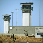 Guard towers are seen last year at High Desert State Prison in Indian Springs, one of Nevada's toughest prisons.