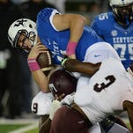 UK QB Patrick Towles is sacked during the first half of the University of Kentucky - Eastern Kentucky University football game at Commonwealth Stadium in Lexington, Ky., on Saturday, October 3, 2015. Photo by Mike Weaver