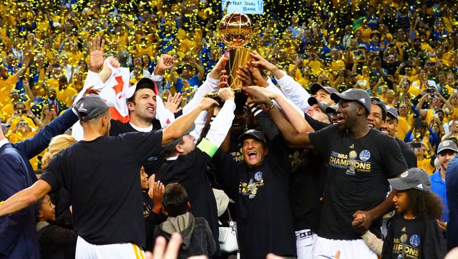 The Golden State Warriors celebrate beating the Cleveland Cavaliers in Game 5 of the 2017 NBA Finals.