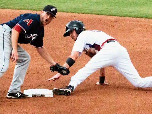Reno Aces infielder Danny Worth turns to look at the umpire as El Paso Chihuahuas baserunner Travis Jankowski tries to stay on at second base Sunday at Southwest University Park. Jankowski was ruled out.