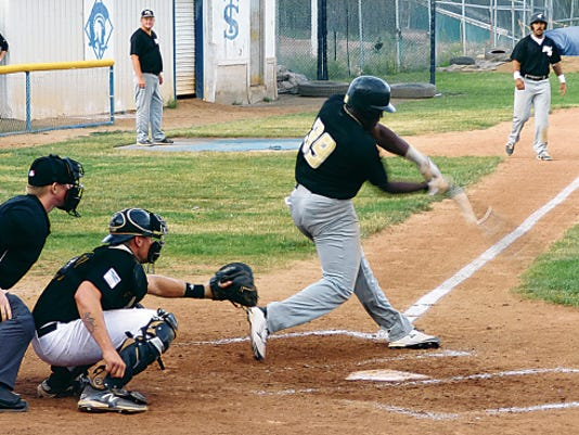 Brandon Burkes connects for a base hit June 27 at Trinidad's Central Park.