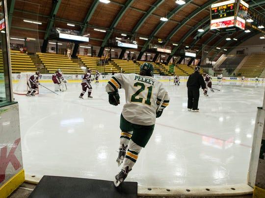 Catamounts forward Amanda Pelkey (21) takes the ice