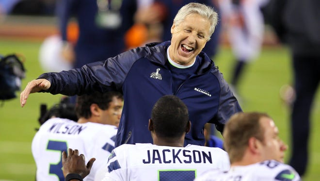 Seattle Seahawks head coach Pete Carroll having fun with his players on the field before Super Bowl XLVIII.