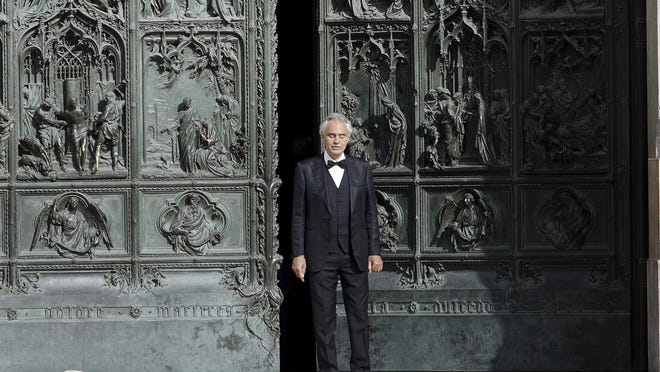 In this Sunday, April 12, 2020, Italian singer Andrea Bocelli performs outside the Duomo cathedral, in Milan, Italy. Italian tenor Andrea Bocelli, who had COVID-19, says the pandemic lockdown in his country made him feel þÄúhumiliated and offendedþÄù for depriving him of freedom. Bocelli spoke at a panel held on Monday in a Senate conference room, where he was introduced by right-wing opposition leader Matteo Salvini, who has railed against the government's stringent measures aimed at reining in the coronavirus outbreak.