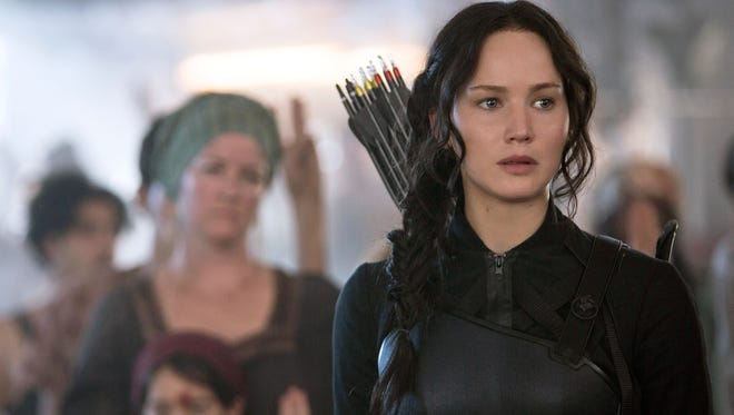"""""""The Hunger Games: Mockingjay — Part 1,"""" starring Jennifer Lawrence, was No. 1 over the Thanksgiving holiday weekend."""