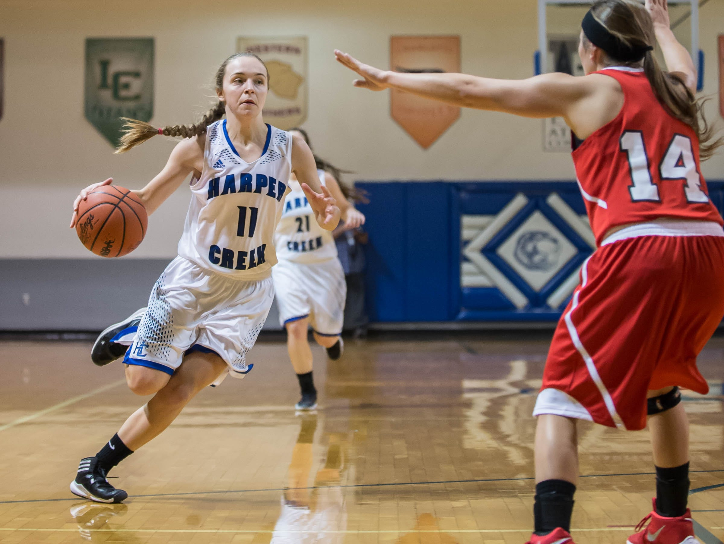 Harper Creek's Macy Hancock drives down the court against Coldwater in Friday evening's game.