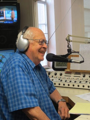 Longtime Phillipsburg radio personality Tad Felts laughs as he interviews a rodeo guest. Felts has attended the rodeo nearly every year since he and his wife Patt moved to Phillipsburg more than fifty years.