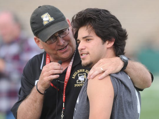 Abilene High football coach Del Van Cox, left, interviews the Warbirds' Juan Antonio Badillo Jr. after Badillo scored a touchdown in the 10th annual Game of Champions football game Tuesday, May 22, 2018 at Shotwell Stadium.