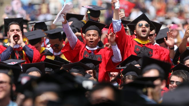 Graduates cheer during Rutgers University's 249th anniversary commencement, Sunday, May 17, 2015, in Piscataway, NJ.