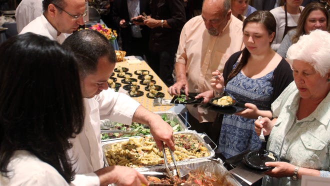 Attendees sample food from 337 Grill in Manville at the 23rd annual Taste of Somerset on Monday evening.