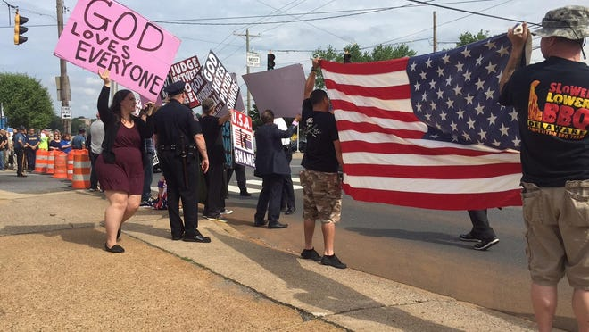 Westboro Baptist Church protesters are drowned out by counter protesters Saturday at the intersection of Pennsylvania Avenue and North DuPont Street.
