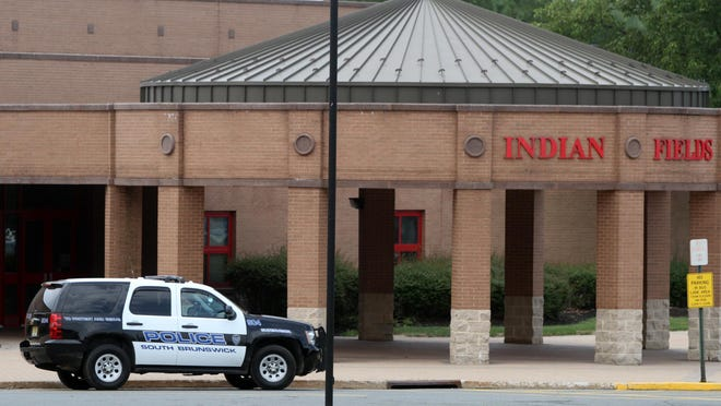 A South Brunswick police vehicle is parked outside Indian Fields Elementary School on Monday.