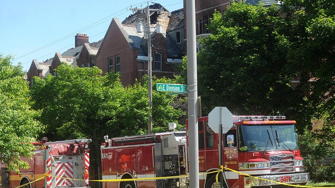 Firefighters investigate a fire at a historic Fond du Lac convent Saturday. The building was still smoldering a day after it was extinguished.