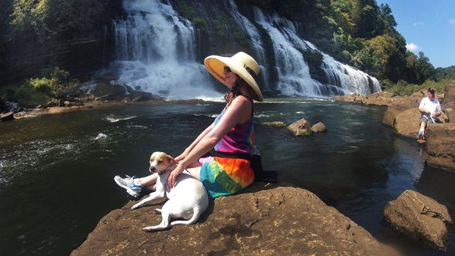 Kristy Skinner and dog Leia take in the views at Rock Island State Park.