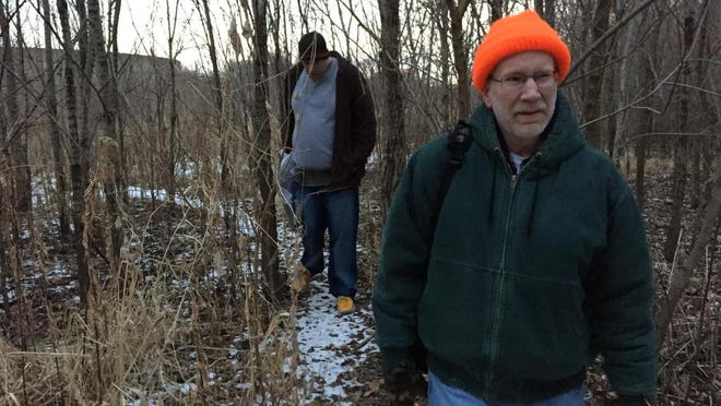 Kurt Harker, foreground, a case manager for Wabash Valley Alliance, heads into the West Lafayette woods during the 2015 Point-in-Time Count.