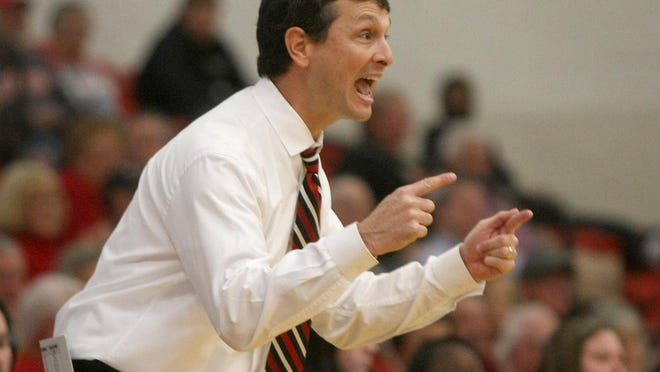 Union University head coach Mark Campbell yells to his players during Saturday's win over Lee.