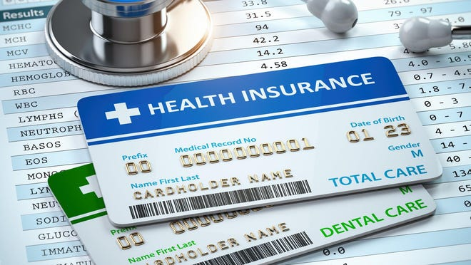 Health insurance cards and a stethoscope on test results