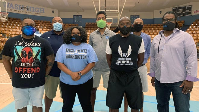 Washington Middle School/High School, Black educators Stephen Cherry, front from left, music teacher, Teresa Booker, dean of students and former special education teacher, Richie Barnes, truancy officer, and Damon Lewis, science teacher, rear, from left, Chet Henderson, principal, Rashaud Olson, language arts teacher and Treg Campbell, English teacher, are shown Wednesday in Washington, Pa. According to the state Department of Education, less than 5% of Pennsylvania teachers are people of color, compared with more than 33% of its students - among the widest gaps in the United States.