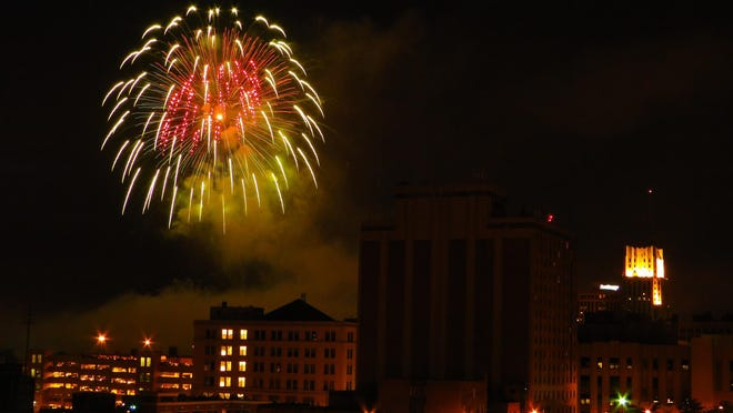 Fourth of July fireworks explode over downtown Akron.