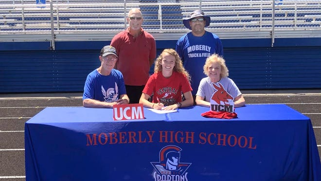 Moberly High School senior Molly Greene sits between her parents Kimber and Glenna as she signed a letter of intent Thursday, June 11 to participate in women's track while attending the University of Central Missouri in Warrensburg for the 2020-2021 academic year. Greene will compete in the pole vault and pursue a degree in kinesiology. Standing is Dr. Brad Freidel, her pole vault coach in the off season, and to the right is Moberly Spartans head track & field caoch Tony Stoneking.