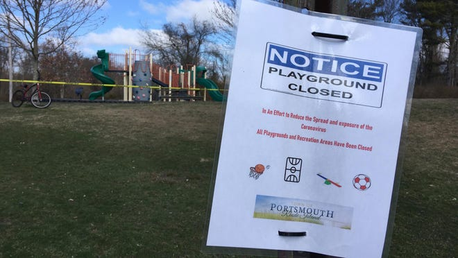 A sign informs residents the playground in the Redwood Farms neighborhood of Portsmouth is closed.