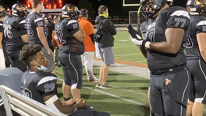 Cathedral Prep senior lineman Jaheim Bassham, right, talks to running back Jaheim Williams, seated, during Prep's 55-21 win in a Region 9 game on Friday, Sept. 11, 2020, at Dollinger Field.