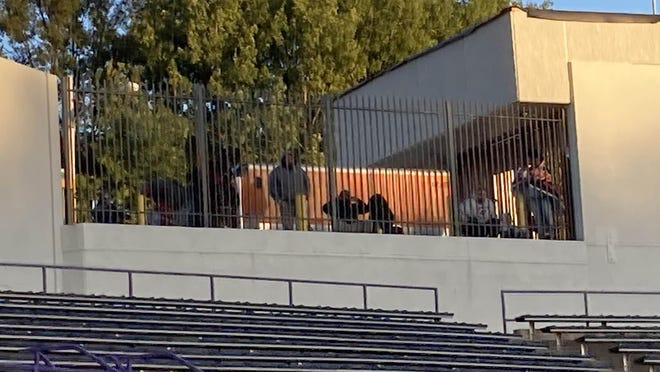 Fans watch from behind the fence at Veterans Stadium as the Erie High football team plays Cathedral Prep on Friday night, Sept. 18, 2020. No fans were allowed in the stadium because of the COVID-19 pandemic. Prep won 48-26.