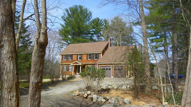 Nearly five acres of property include a rolling back lawn, a floating dock on the river, granite outcroppings and charming rock gardens.