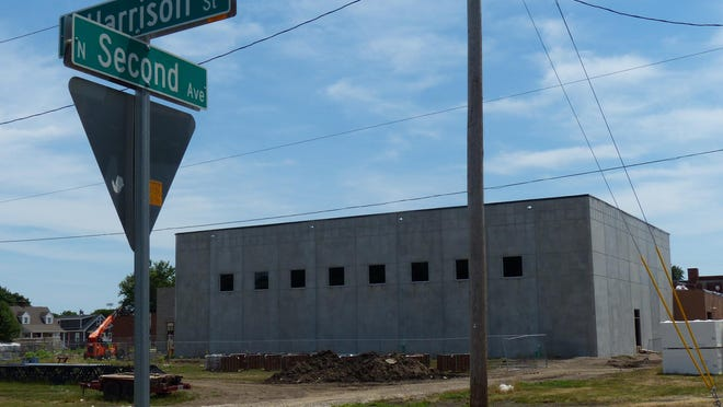 A new gymnasium under construction at Morton Junior High School is visible from the corner of East Harrison Street and North Second Avenue. Houses on East Harrison will be torn down to make way for a 156-space parking lot.