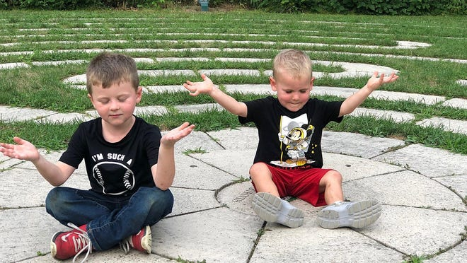 Christopher Falcon, 5, and William Falcon, 3, got in some meditation at the labyrinth at Frontier Park with their father, Drew Falcon.