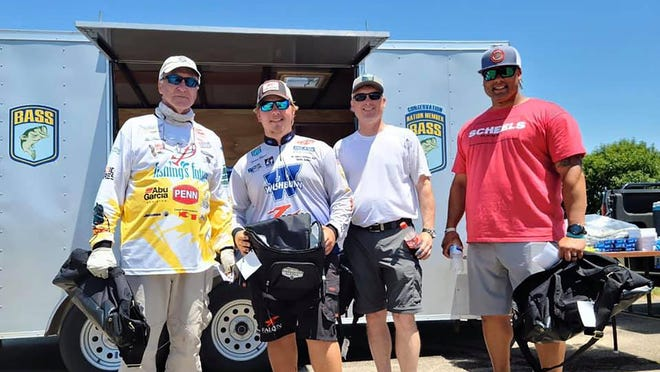 From left, the Topeka team of Rue Armstrong and Thomas Heinen tied with fellow Topekans John Burns and Nick Butler for third place at the Frank Stong Memorial Scholarship Tournament last weekend on Melvern Reservoir.