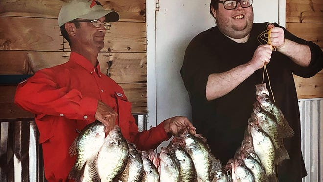 Topeka Capital-Journal outdoors editor Josh Rouse, right, and Lawrence-area tournament angler and fishing guide Joe Bragg hold up a big stringer of crappie after a recent fishing trip in the Flint Hills with KVOE radio host Phil Taunton (not pictured).