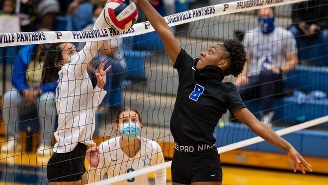 Talia Tamez of Ann Richards, left, and Dianna Greene of Pflugerville joust above the net during a Class 5A first-round playoff match Nov. 19 at Pflugerville High School. Ann Richards, the District 17-5A champions, won in three sets.