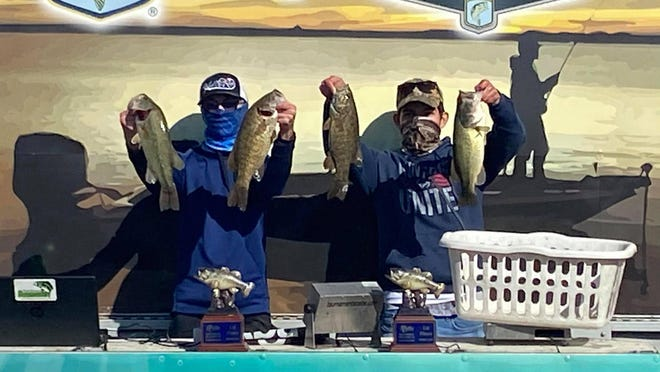 From left, Olathe East's Wyatt Peterson and Miguel Cooper hold up the winning bag of fish Oct. 3 at the second Kansas BASS Nation High School qualifier of the fall at Melvern Reservoir.