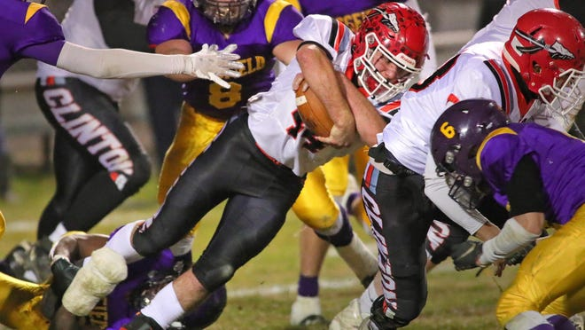 Clinton's Brayden Randolph runs with the ball during the Division 6 district final at Blissfield.