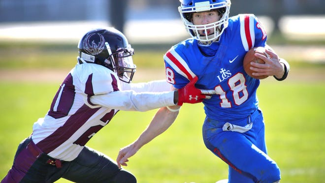 Lenawee Christian's Jameson Chesser runs with the ball during a 2020 playoff game.