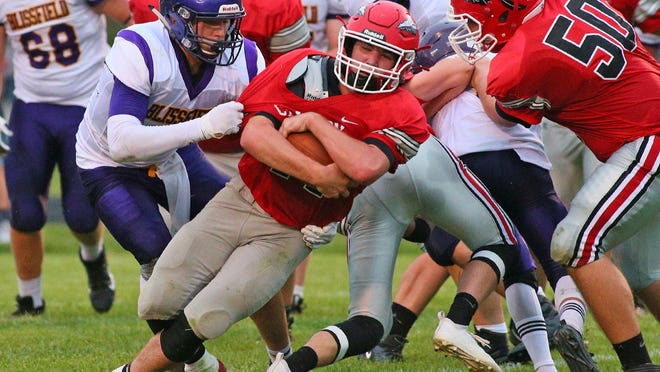 Blissfield's Zack Horky, left, looks to take down Clinton's Brayden Randolph during a game in the 2019 season. What was once a non-league game now becomes a Lenawee County Athletic Association matchup as Clinton rejoins the LCAA.