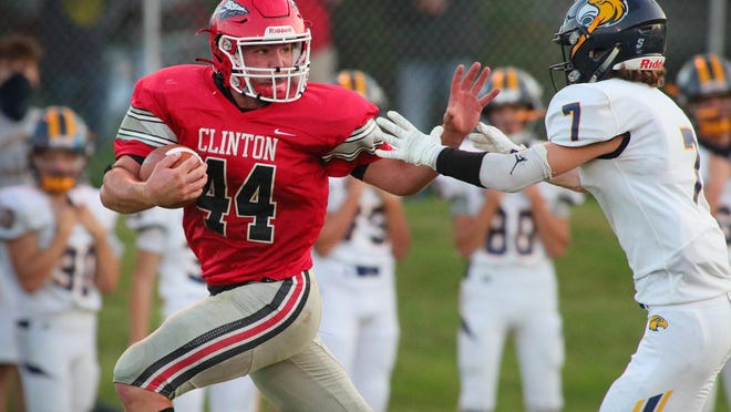 Clinton's Brayden Randolph runs with the ball during Friday's game against Columbia Central.